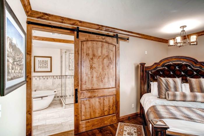 large sliding bathroom door with black barn door hardware