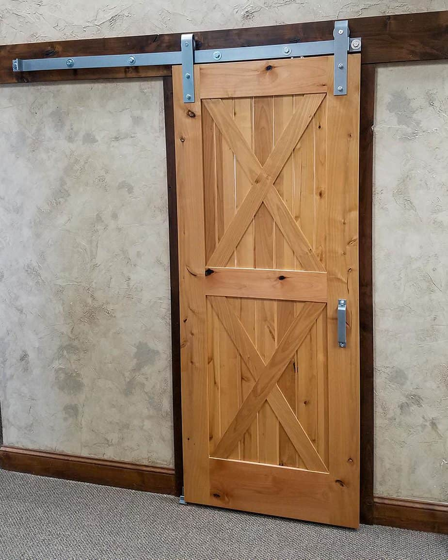 barn style sliding door with silver colored barn door hardware