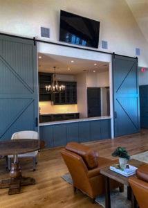 large blue sliding doors with black barn door hardware