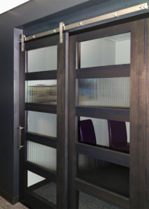 sliding office door with stainless steel barn door hardware