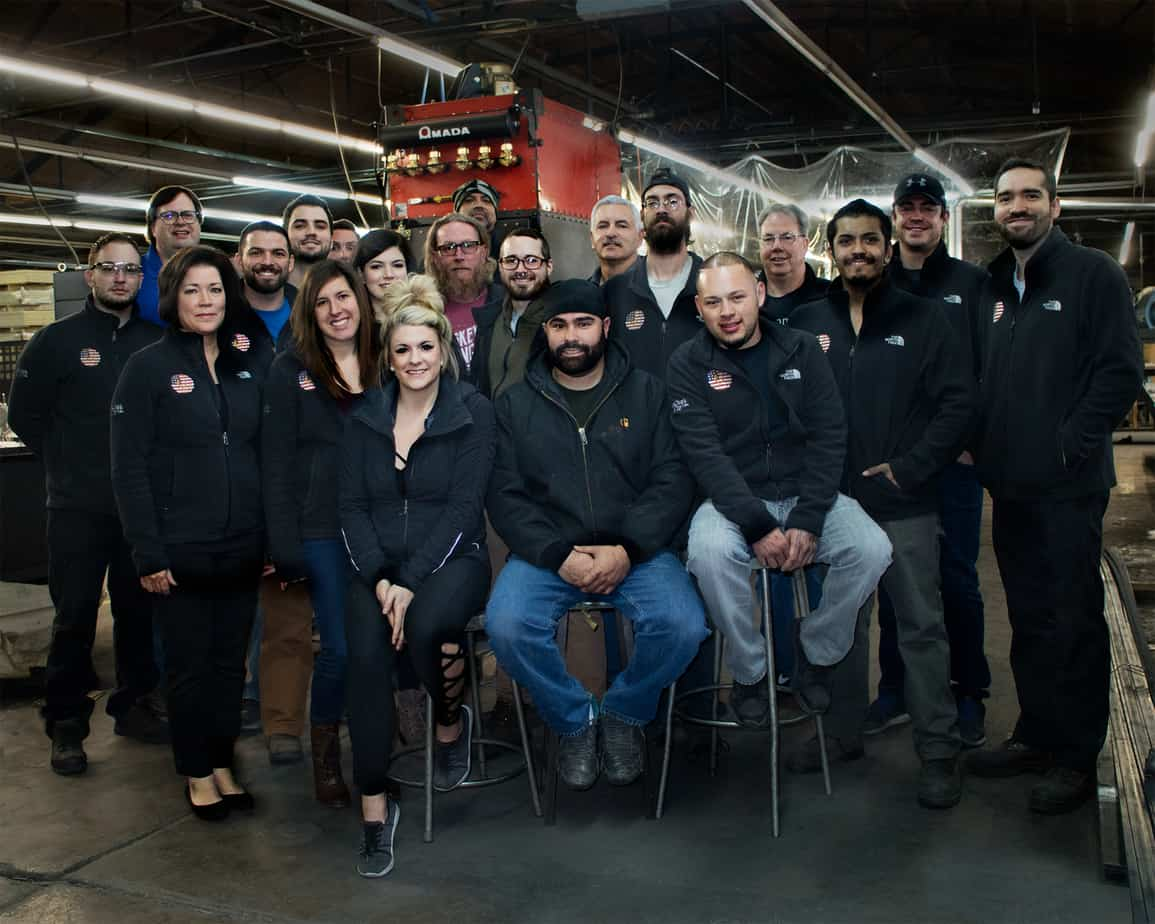 The Goldberg Brothers team poses for a photo inside their factory near Denver's Stapleton neighborhood in 2017.