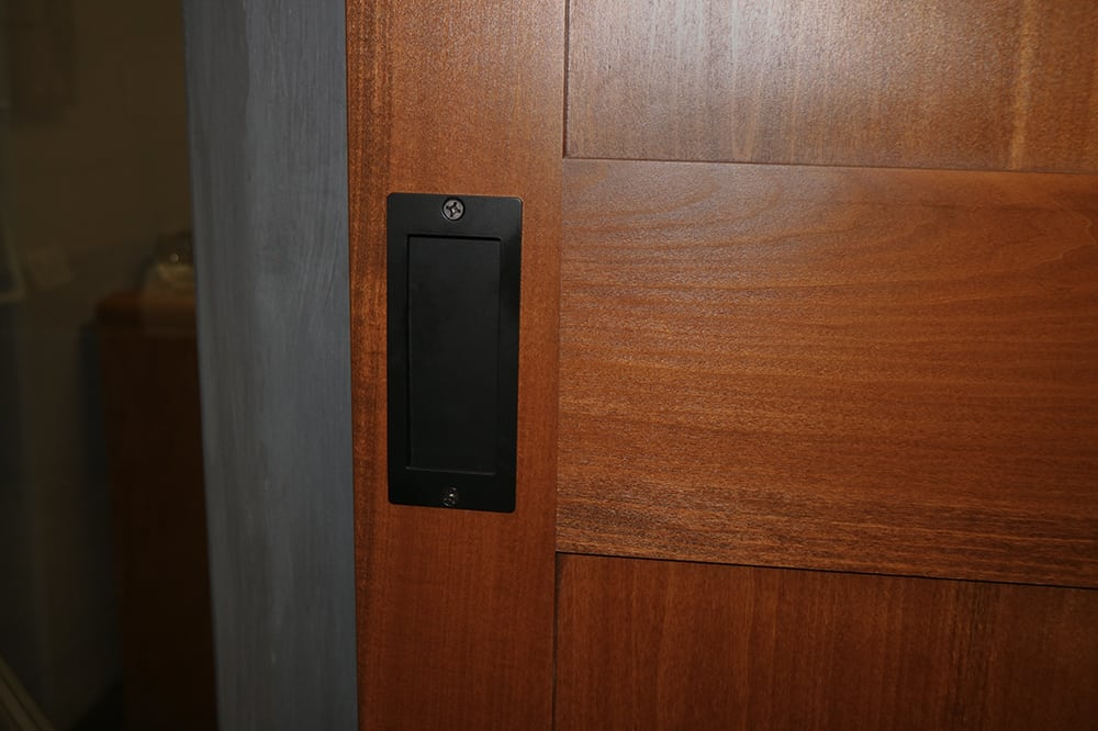 sliding door with black flush pull handle