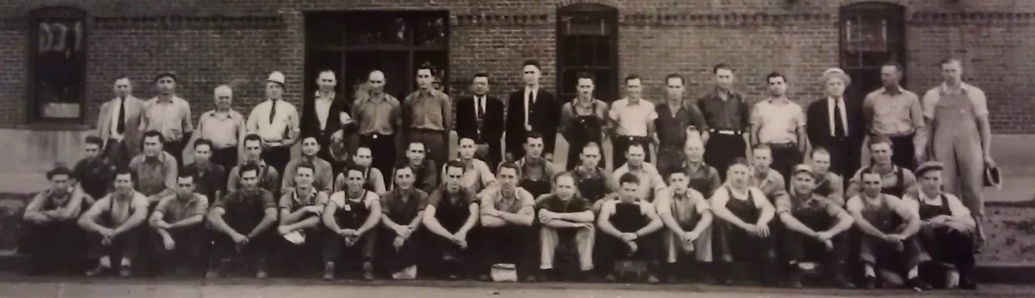 Owners and employees pose for a group photo outside Goldberg Brothers headquarters near downtown Denver, July 18, 1939.