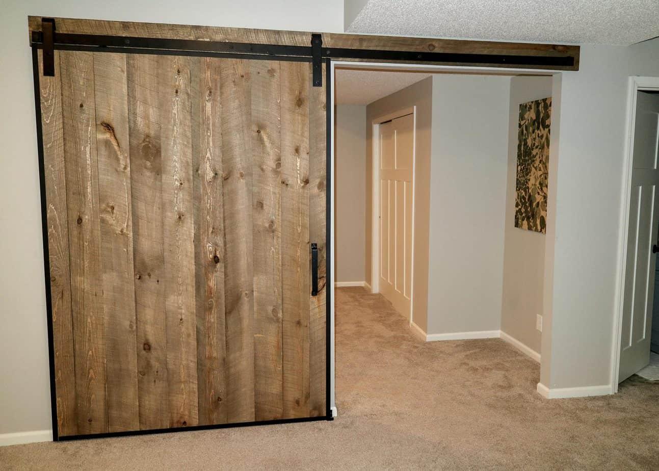 rustic wood door with black steel edge wrap channels