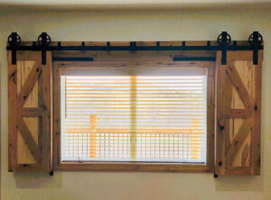 opened window shutters with Goldberg Brothers Standard Series and Hidden Roller Series hardware