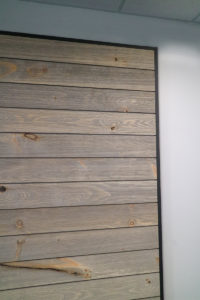 shiplap sliding door with no visible barn door hardware