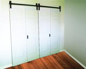Goldberg Brothers Barnfold door hardware for four door panels, closed position