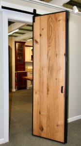 Barnfold folding barn door hardware and Barn Door Edge Wrap in a showroom display