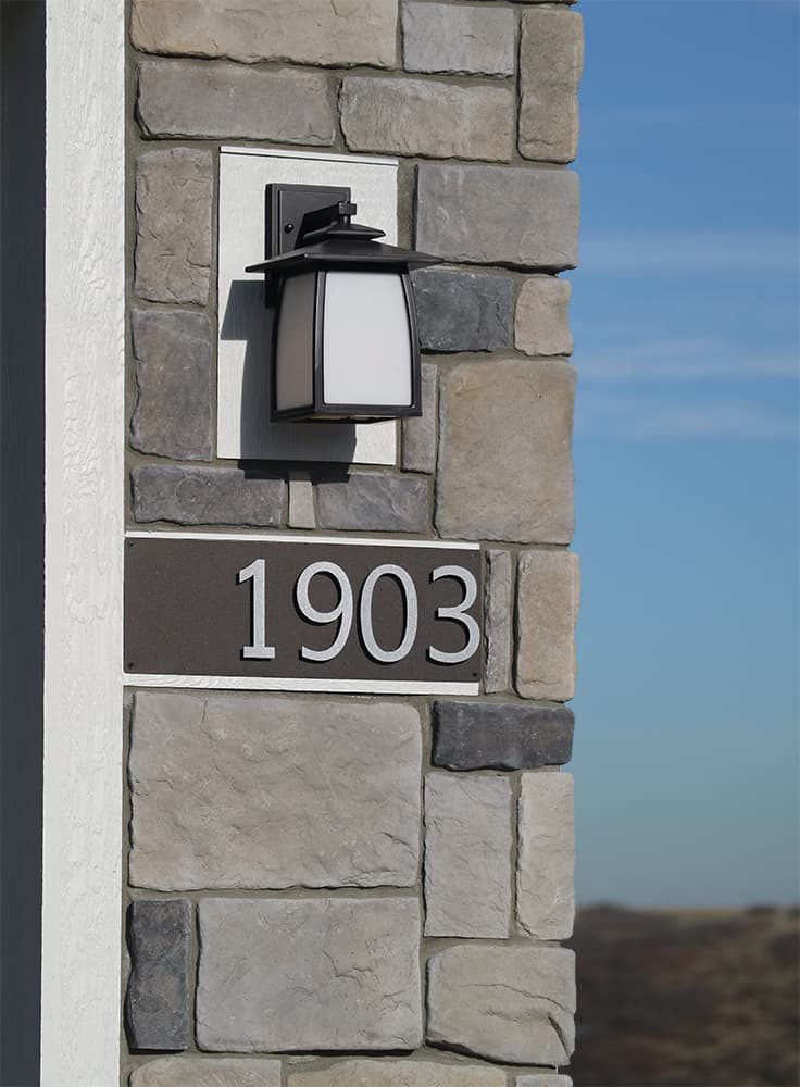 address number sign on house with block siding